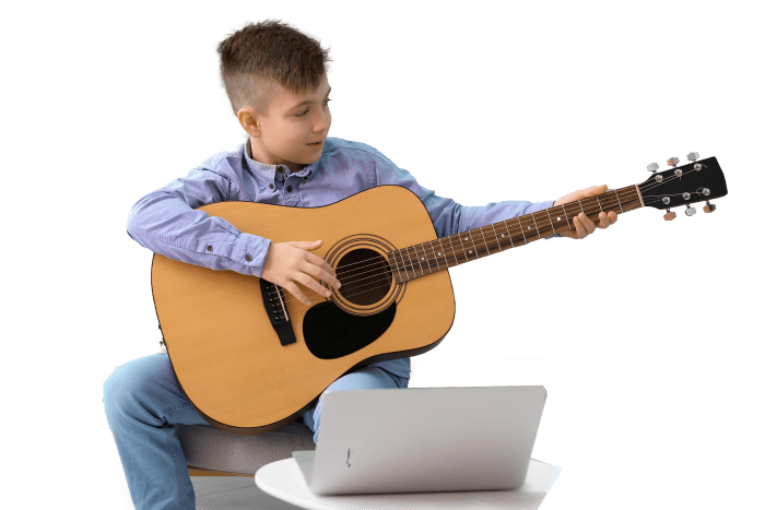 little-boy-taking-music-lessons-online-at-home